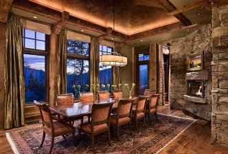 Interior, horizontal, dining room at twilight, Olivier Nomellini residence, Yellowstone Club, Big Sky, Montana; Locati Architects; Design Associates; Schlauch Bottcher Construction