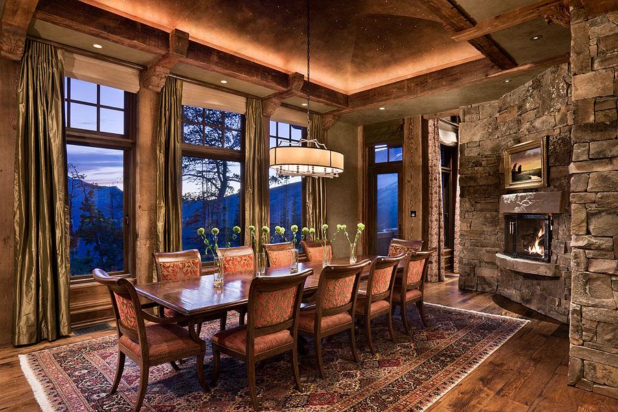 Interior, horizontal, dining room at twilight, Olivier Nomellini residence, Yellowstone Club, Big Sky, Montana; Locati Architects; Design Associates; Schlauch Bottcher Construction